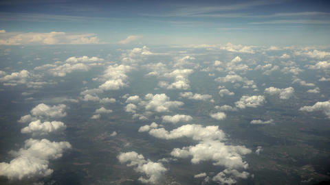Clouds and Earth. View from a Plane Window Footage