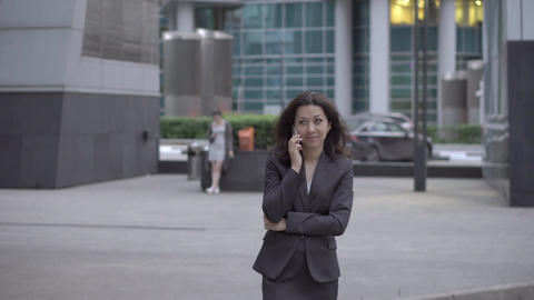 Businesswoman approaching to camera while talking Footage