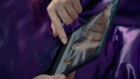 Woman Shopping Online Using A Tablet PC Footage