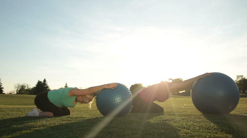 Adult women working out in park with fitness balls Live Action