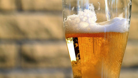 Pouring beer into a glass Stock Video Footage