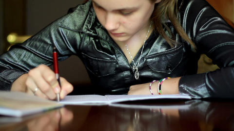 girl doing homework. 5 Stock Video Footage