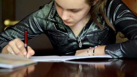 girl doing homework. 5 Stock Video Footage