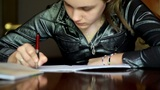 girl doing homework. 5 Footage