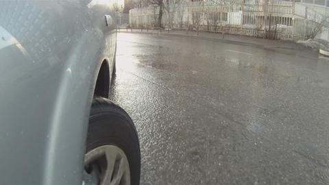car goes through the puddles time lapse Stock Video Footage