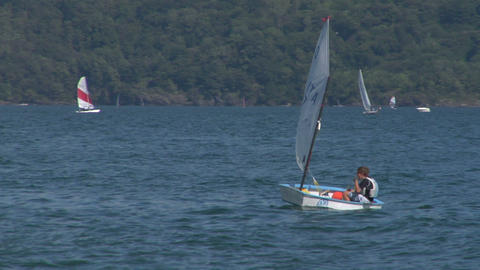 small boat sailing school 01 Stock Video Footage