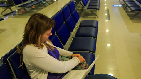 Blond Girl Puts Iphone Laptop into Bag Goes at Airport Terminal Footage