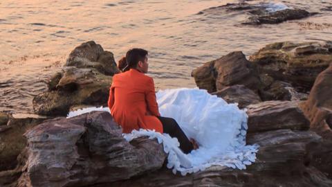 Closeup Backside Girl Guy Admire Scenery Sit on Rocks by Sea Footage