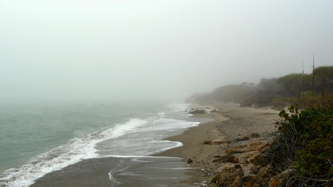 Sea fog overwhelmes an empty beach, 4K Footage