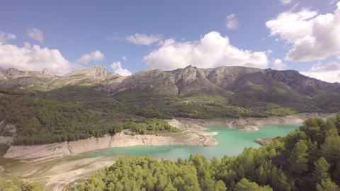 Aerial view of reservoir and dam at Guadalest and mountains in background Footage