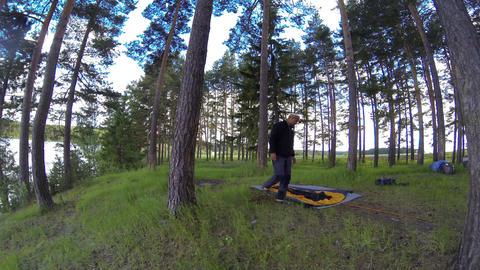 Assembling a tent on the nature. Om River, Syropyatskoe village, Kormilovsky Dis Footage