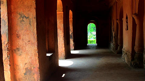 Slow zoom inside a historical building with arches in Assam,India Footage