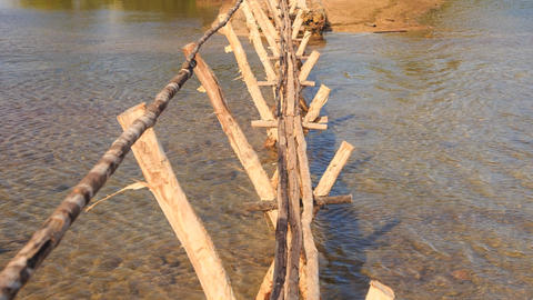 View of Narrow Wooden Bridge with Hand-rails across Water Footage