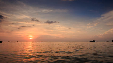 Silhouettes Swim Boat Drifts in Sea at Sunset Sun Reflection Footage