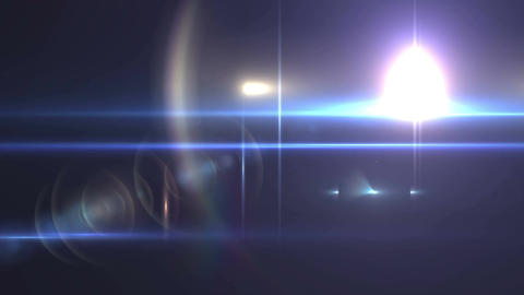 Lens flare light rapidly flashes on a black Animation