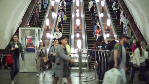 People walking down the escalator in the metro Footage