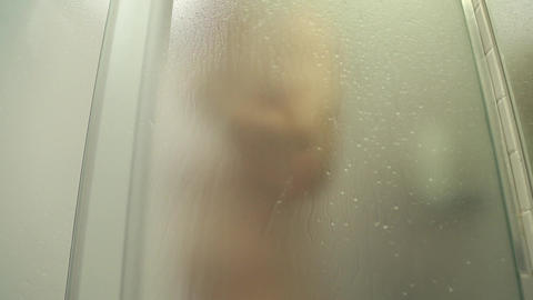 Man taking a shower Footage
