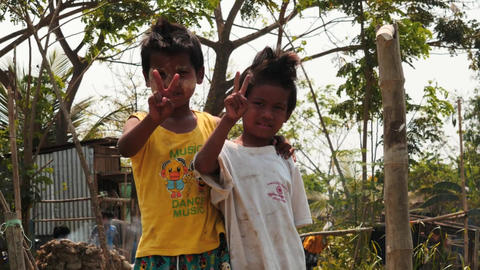 Burmese children posing and shows victory signs smooth zoom Footage