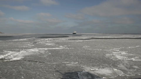 The ship is moving across the sea covered with ice. Ship on the horizon Footage