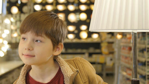 Closeup Happy Boy Plays and Hides behind Floor Lamp Footage
