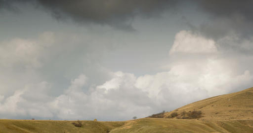 Cloudy sky above the hilly valley. timelapse Live Action