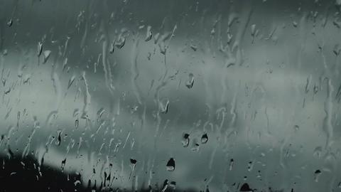 Streams of rain on the glass, macro shot Footage