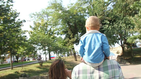 little son ride his happy father in park Footage