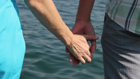 Woman and man, let go of hands against the sea Footage