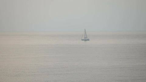 Sailboat float in the evening in the sea Footage