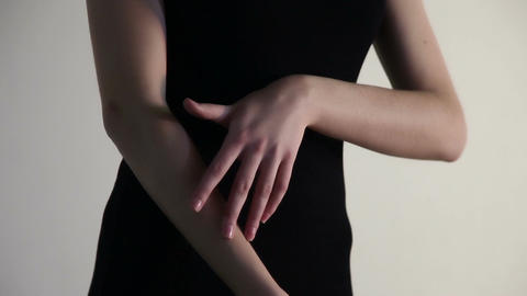 A woman touch her fingers over the arm Footage