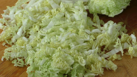 Chinese cabbage sliced on a wooden board Footage