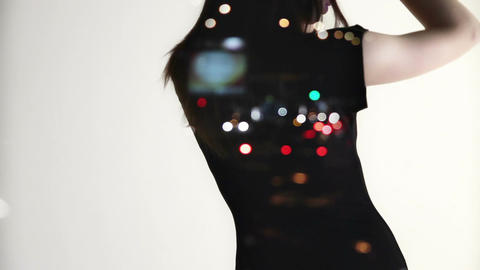 Slowly dancing woman in evening dress on white background and with city lights o Footage
