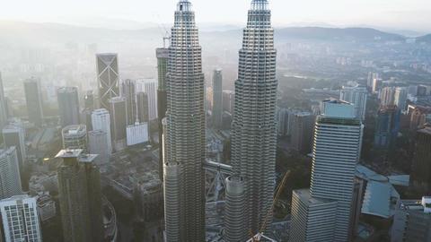 4k b-roll cinematic footage of drone flying above Kuala Lumpur city skyline Footage