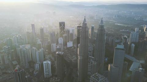 4k b-roll cinematic footage of drone flying above Kuala Lumpur city skyline Image