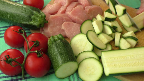 Raw fresh meat on cutting board and fresh vegetables Footage
