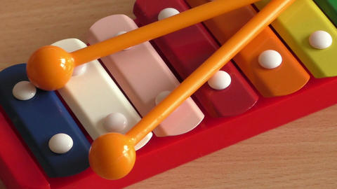 Rainbow colored toy xylophone Footage