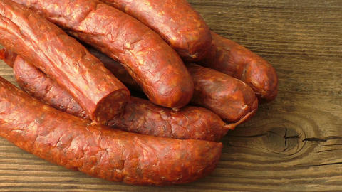 Fresh homemade sausages lying on wooden board Live Action