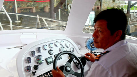 Captain Turns Boat Steering Wheel at Instrument Control Panel Footage