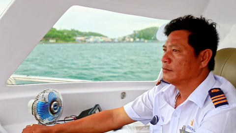Closeup Captain Speeds on Motorboat in Azure Sea Footage