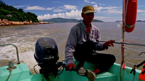 Closeup Man Sits on Boat Stern Controls Engine Footage