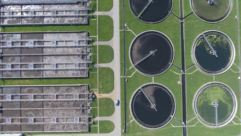 Sewage farm. Static aerial photo looking down onto the clarifying tanks and gree