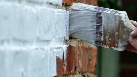 Painting brick house with brush Footage