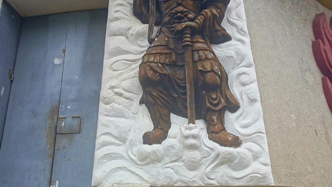 Golden Soldier Bas-Relief on White Panel of Building Wall Footage