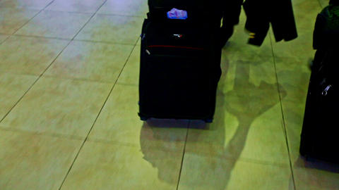 Closeup Large Black Suitcases Pulled on Marble Floor in Airport Footage