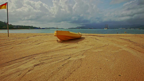 Wooden Boat on Sand Beach against Sea Islands Cloudy Blue Sky Footage