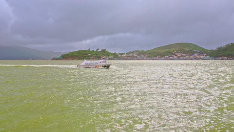 Azure Sea Tourist Motorboat Sails in Waves against Hilly Island Footage