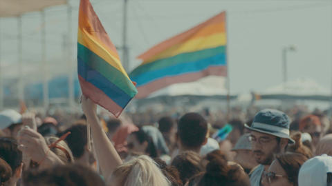 The rainbow flag waving during the Pride parade in Tel Aviv, Israel Footage