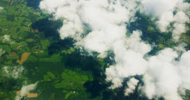 A stunning video of the green fields of land below, taken from above the clouds  Archivo