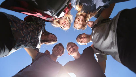 Smiling group of teenage friends in circle Footage
