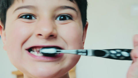 child cleans teeth with a toothbrush in the morning Footage